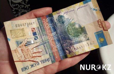 Хочу замуж: Казахстанцы массово пишут свои желания на купюрах