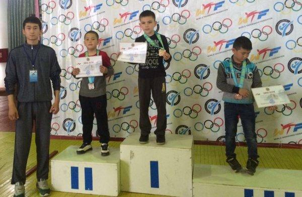 Жанаозенские таеквондисты вернулись из Туркестана с четырьмя медалями