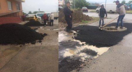 В Алматы сняли на видео укладку асфальта во время проливного дождя