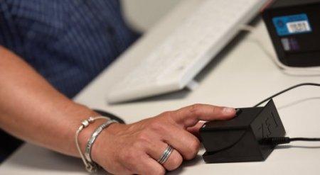 Отпечатки пальцев казахстанцев будут использовать вместо удостоверений - Оспанов