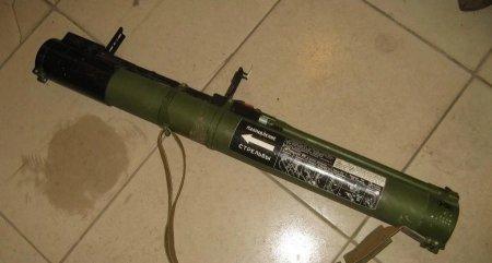 Житель Рудного хранил в ванной реактивную противотанковую гранату и патроны в спальне