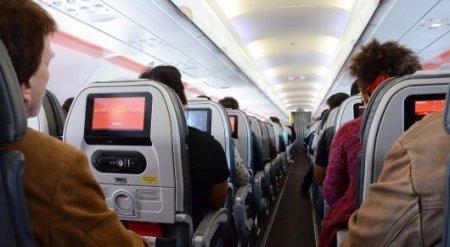 Ужесточить наказание за курение в самолете собираются в Казахстане