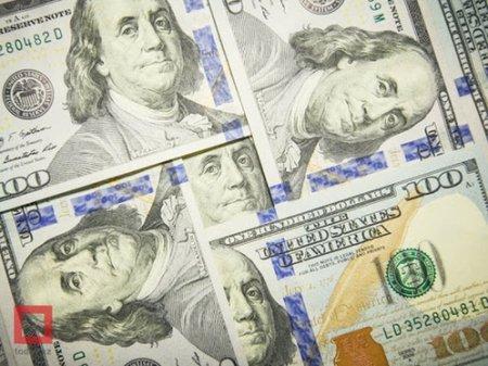Курс доллара составил 448 тенге на KASE