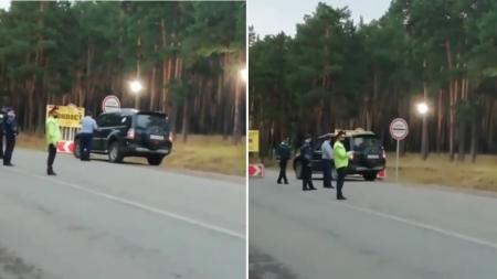 """Полицейских, пропустивших джип через блокпост """"по звонку"""", сняли на видео"""